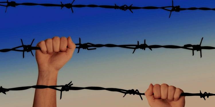 hands borders asylum seekers