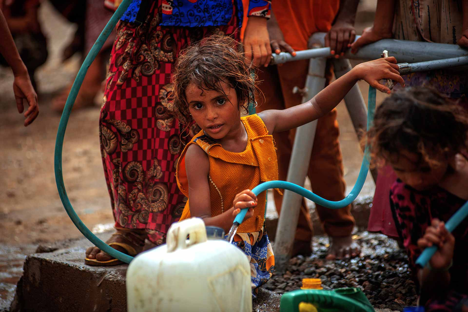 A girl fetch water provided by Solidarités International, an EU-supported aid group