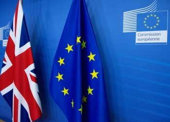 United Kingdom flag, on the left, and European Union flag
