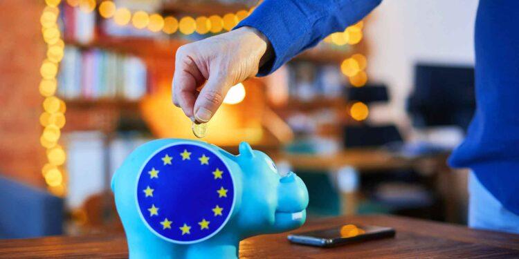 Savings, piggybank and EU flag