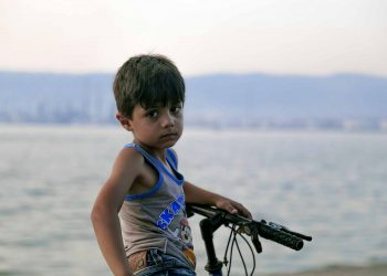 child in war in Syria