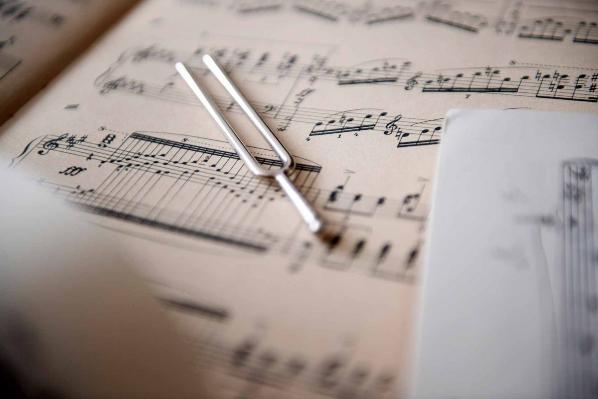 A tuning fork placed on sheet music